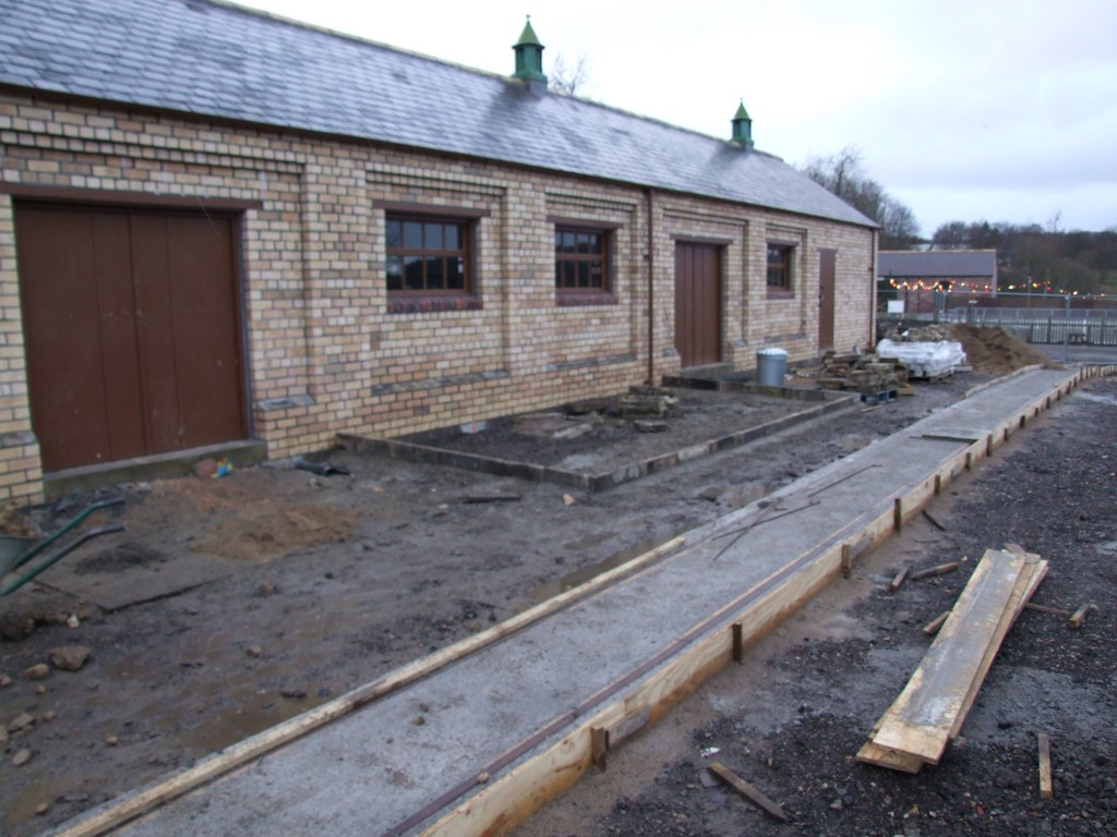 The tub track installed, work has now started to lay the cobbled surface of the Stable Yard