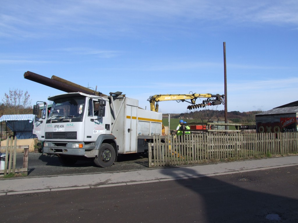 Contractors begin to position the poles