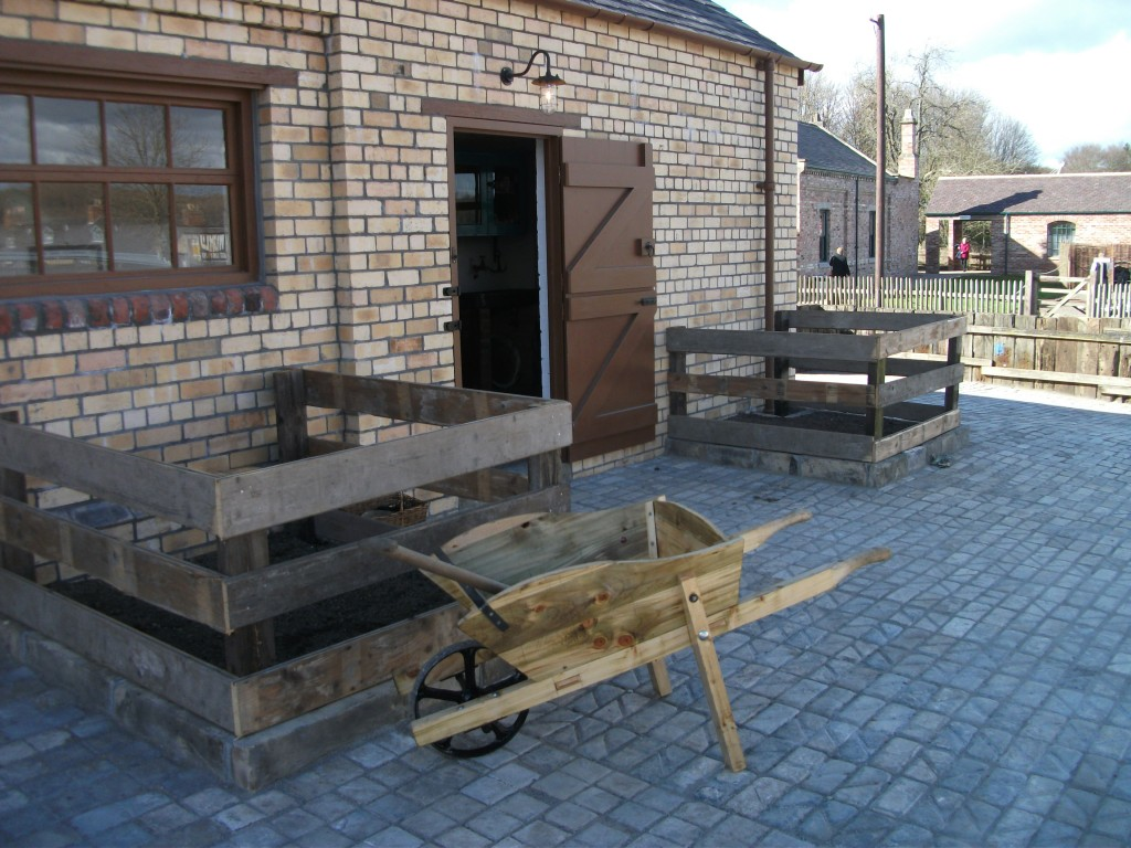A feature of the origianl stables was a series of flower beds which, after studying photographs,appear to have contained roses and gooseberries. Also in the shot one of four new wheel barrows built by the Friends.
