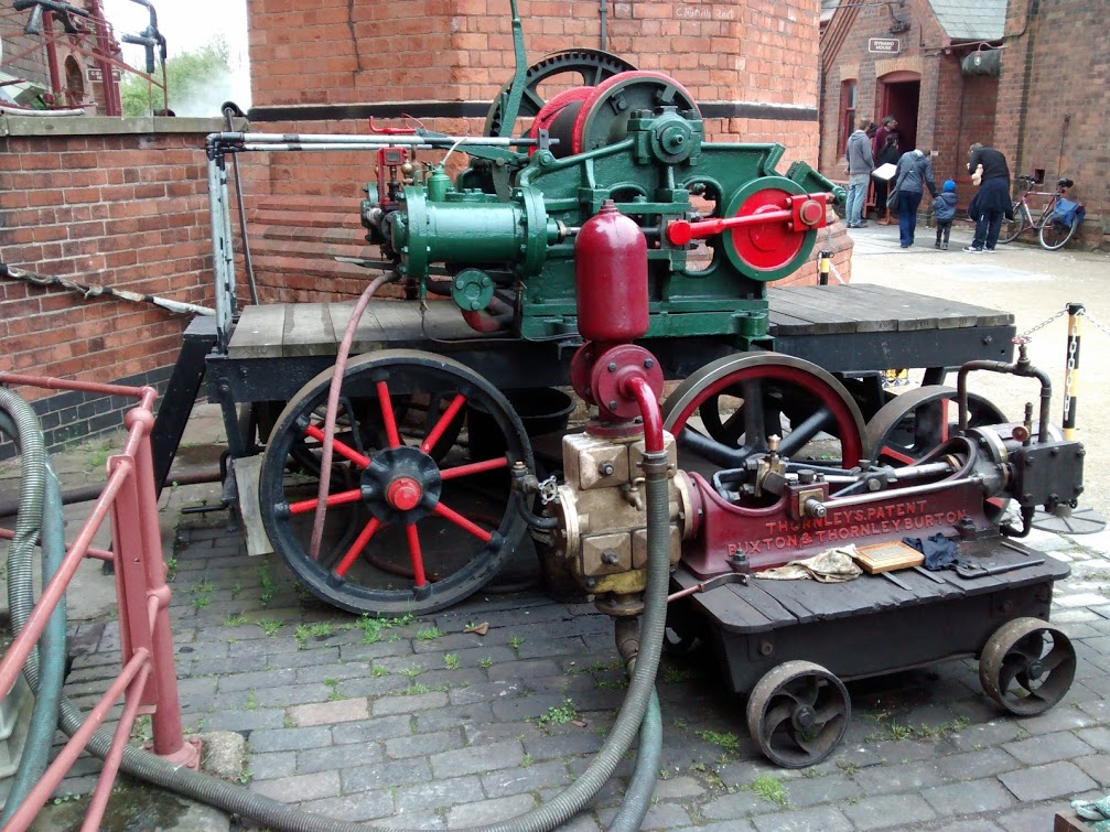 A mobile pump and hauling engine, both in steam.