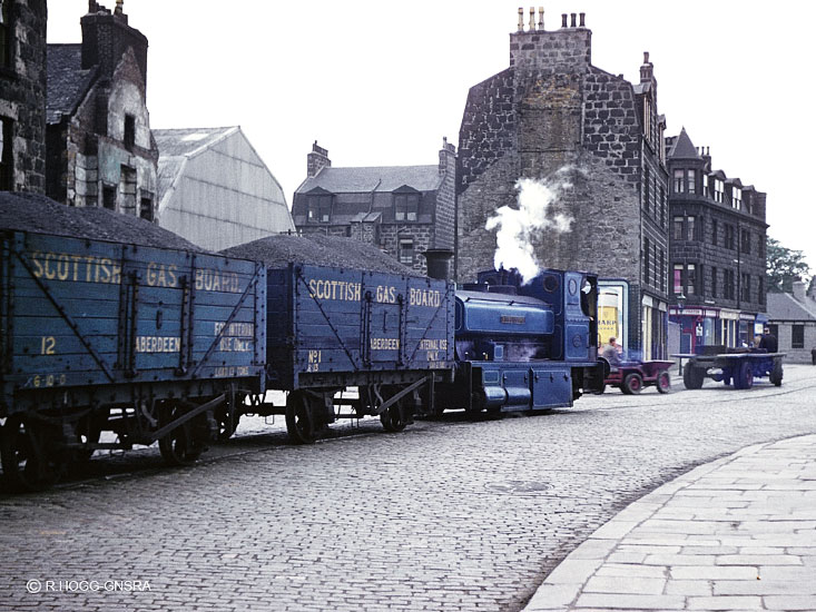 Bon Accord propels 2 wagons for the Gas Works along Miller Street in Abe...